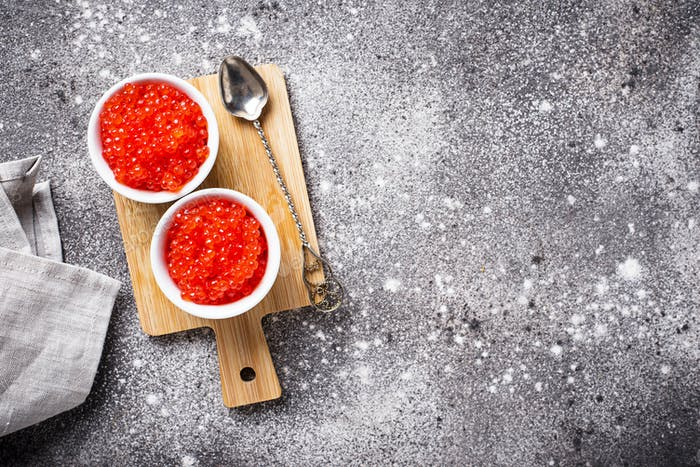 Two bowls with red salmon caviar