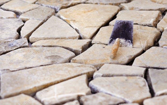 Kelle auf einem Fußboden