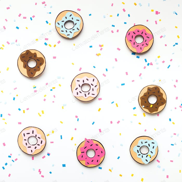 Creative summer background with tasty donuts on white