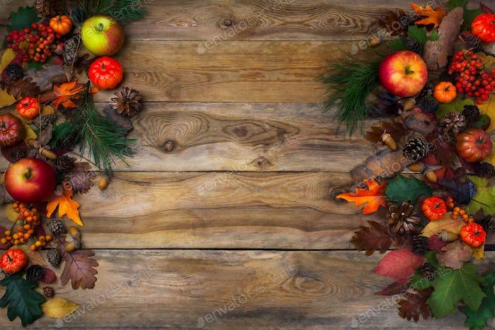 Rustic Thanksgiving decoration with pumpkins and cones