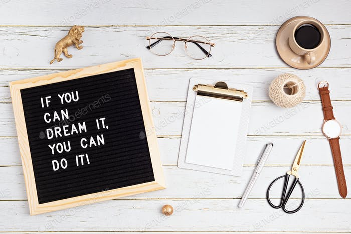 If you can dream it, you can do it. Letter board with motivational quote on white wooden background