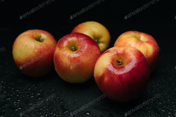 Organic apples on wet floor