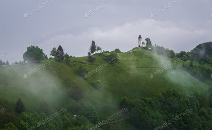 Church on the hill on a stormy summer day