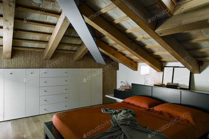 Interiors Shots of a Modern Bedroom in the Attic