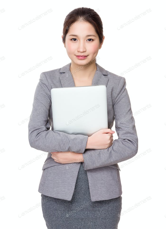Young Businesswoman holding with laptop computer
