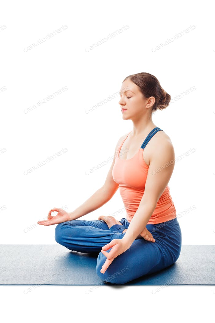 Woman meditating in yoga asana Padmasana Lotus pose