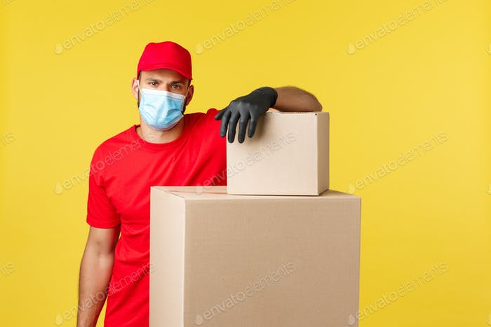 Express delivery during pandemic, covid-19, safe shipping, online shopping concept. Handsome courier