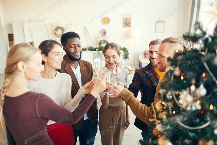 Group of People Toasting at Christmas Party