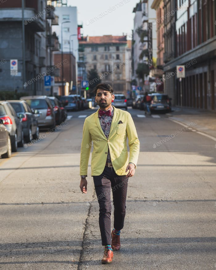 Indian handsome man walking in an urban context