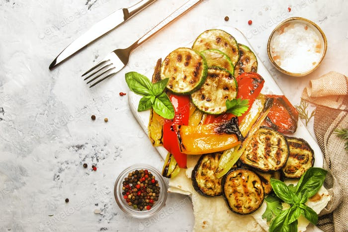 Grilled vegetables, aubergines, zucchini, pepper with green basil