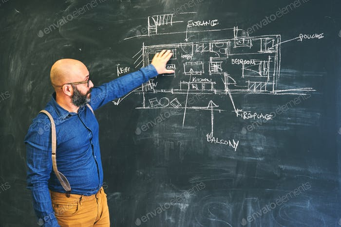 Architect man sketching new project on chalkboard.