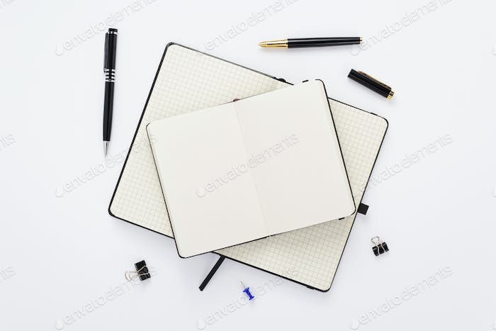 notebook and stationary at white