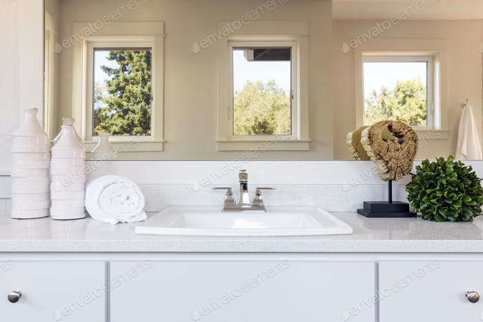 Sink and mirror in bathroom