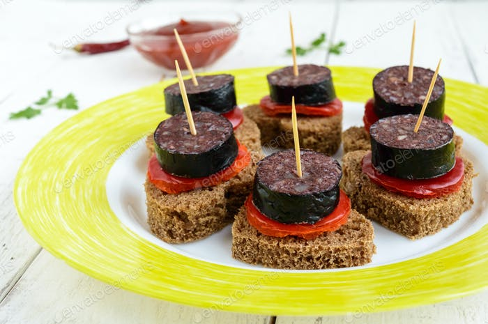 Sandwiches with black rye bread in the shape of a heart, blood sausage (Morcillo)