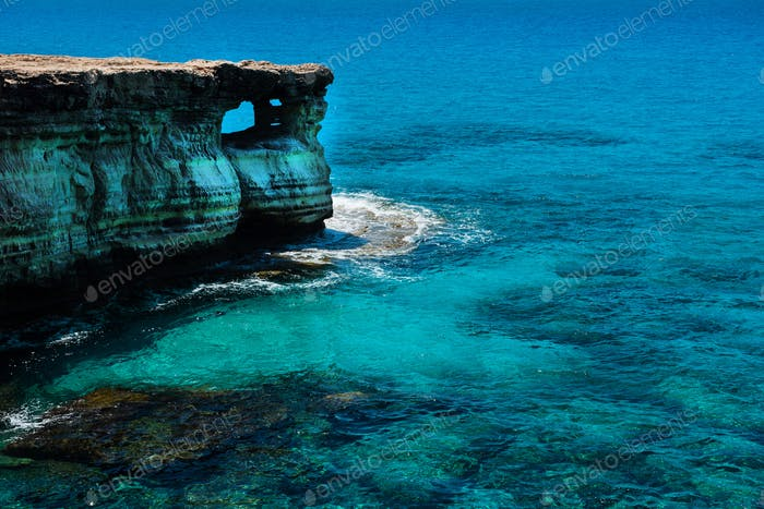 Rocky coastline and sea cave in Ayia Napa, Cyprus