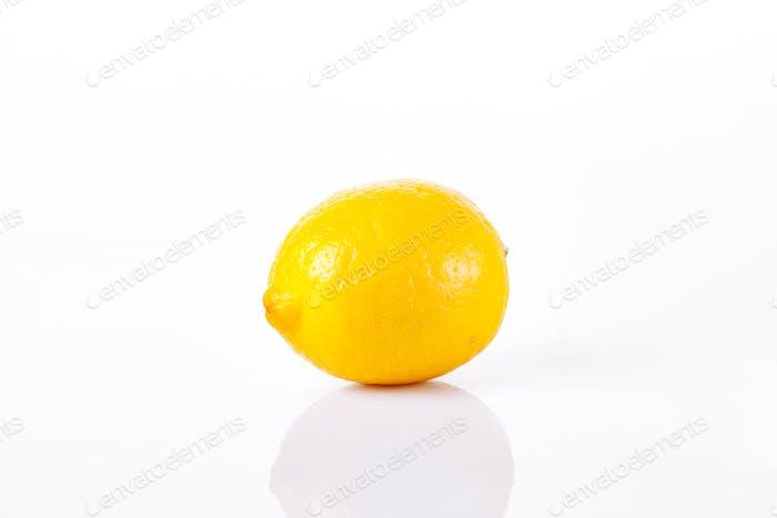 One ripe lemon on a white background