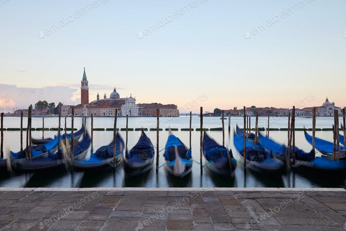 Gondolas movements and canal in Venice before sunset, Italy