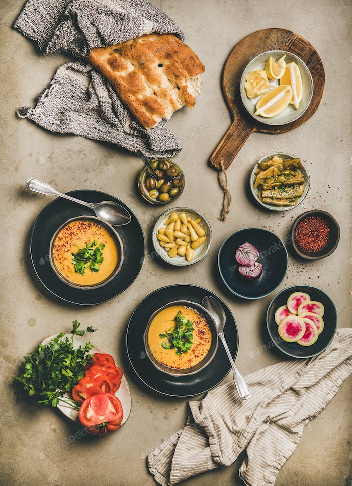 Turkish traditional lentil soup Mercimek, flatbread, vegetables and spices