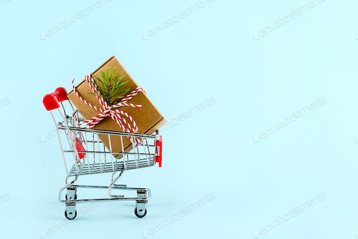Shopping trolley with decorated gift present box. Christmas shopping sale, black friday sale concept