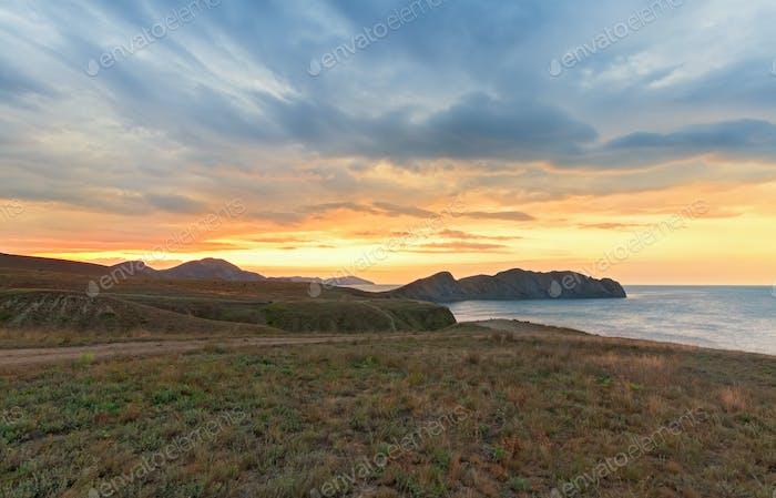 Sunrise over the mountains Cape and the sea