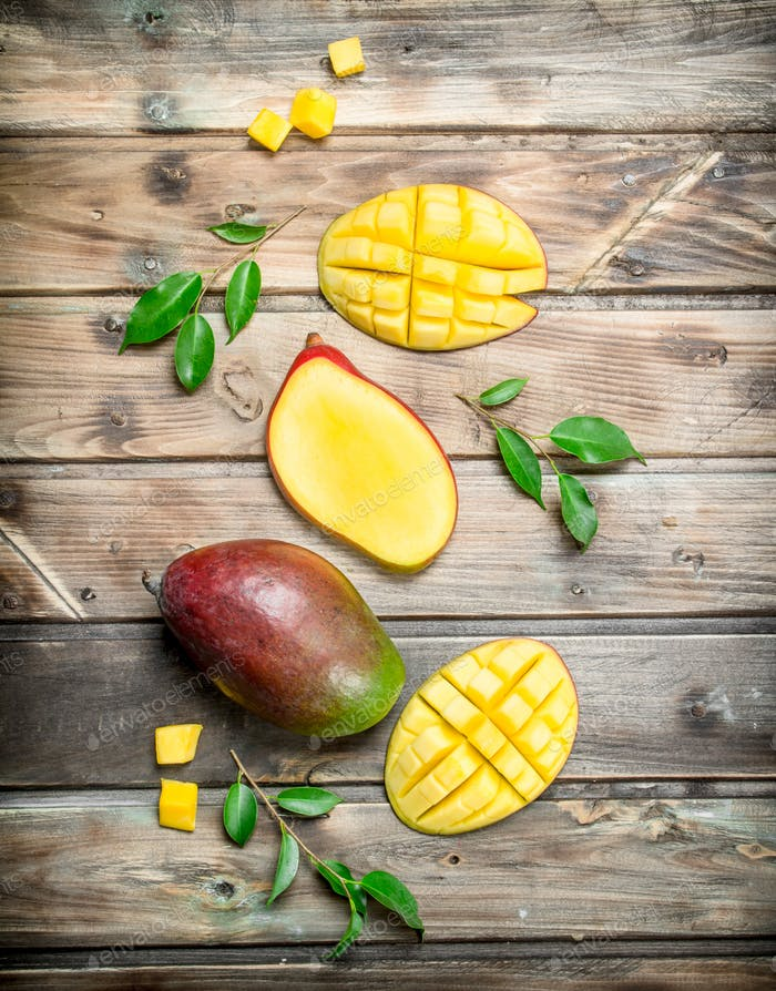 Pieces of mango with foliage.