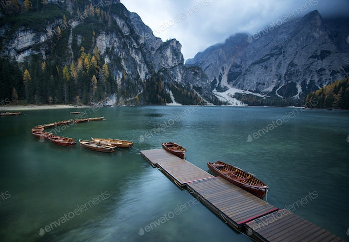 Boats on the Braies Lake ( Pragser Wildsee ) in Dolomites mounta