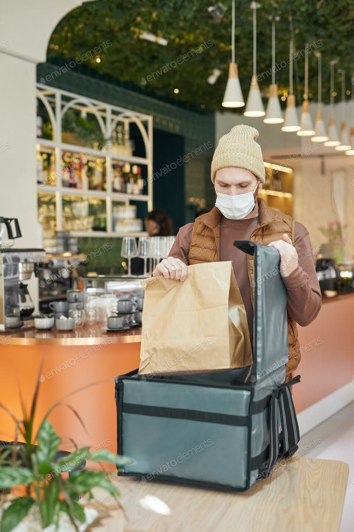 Man Packing Food for Delivery