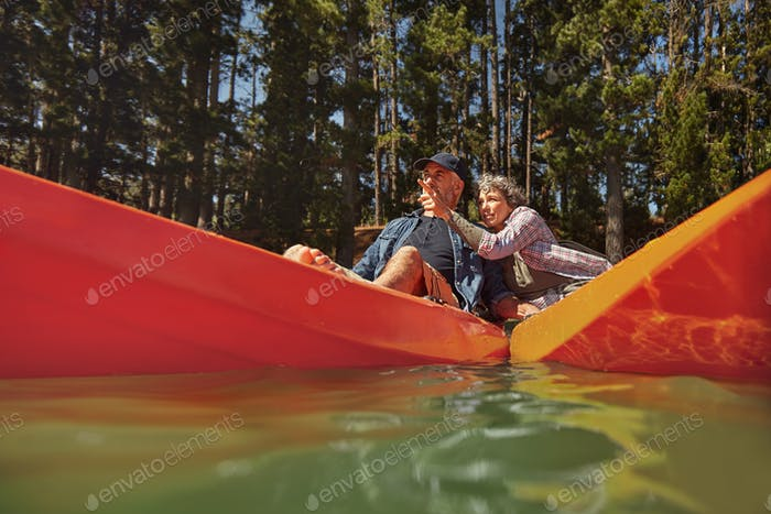 Mature couple enjoying a day at the lake