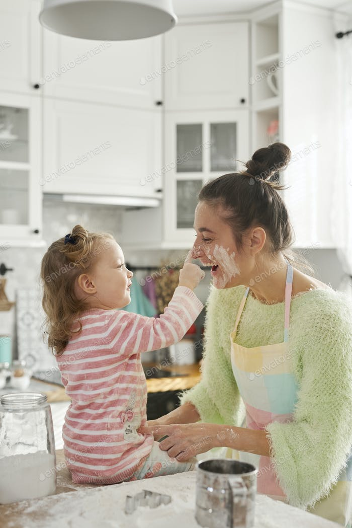 Mum and daughter playing with flour