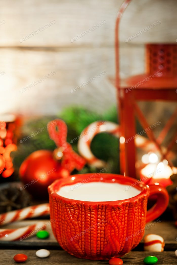 Christmas time red cup of milk and latern with candle light, hol