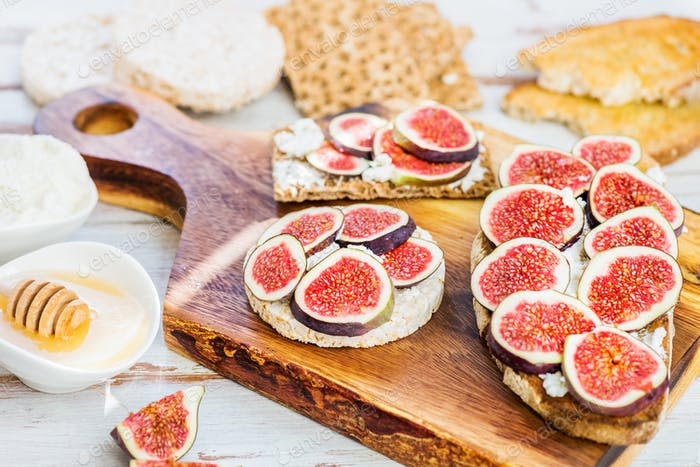Healthy crackers and toast with figs and ricotta cheese