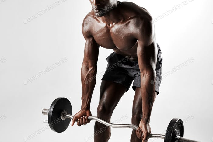 Male bodybuilder exercising with a barbell