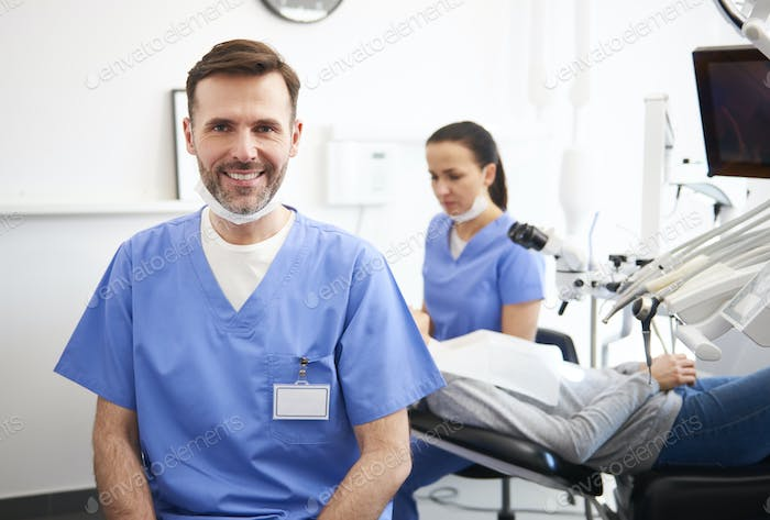 Portrait of smiling male dentist in dentist's clinic