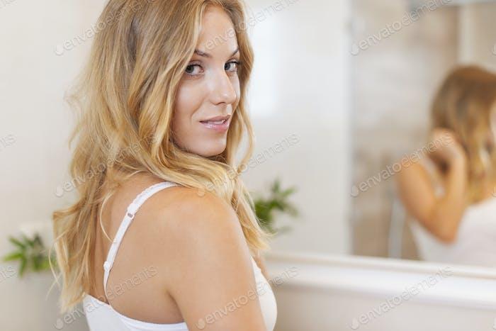 Portrait of beautiful woman in bathroom