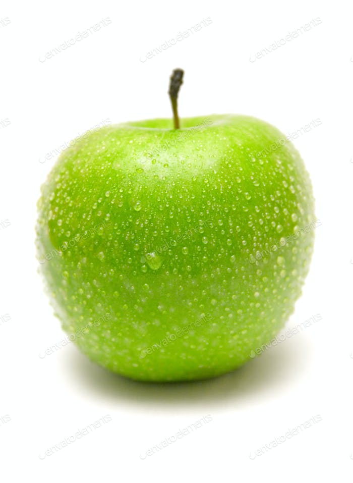 Green Apple with Raindrops Isolated on a White Background