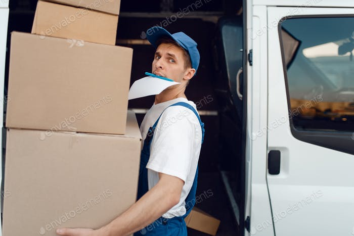 Loader holding stack of parcels, delivery service