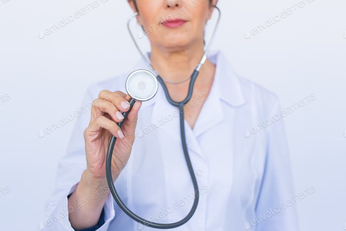 Female doctor with stethoscope, close up over white background
