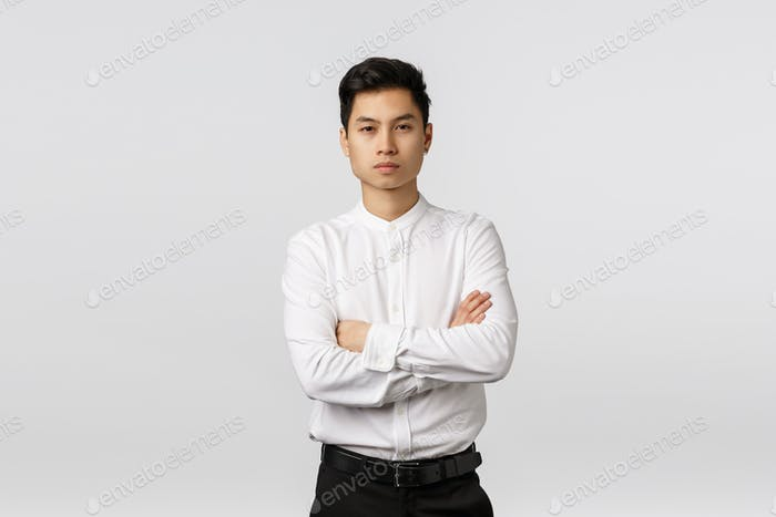 Corporate promo, recruitment and business concept. Attractive self-assured asian male entrepreneur