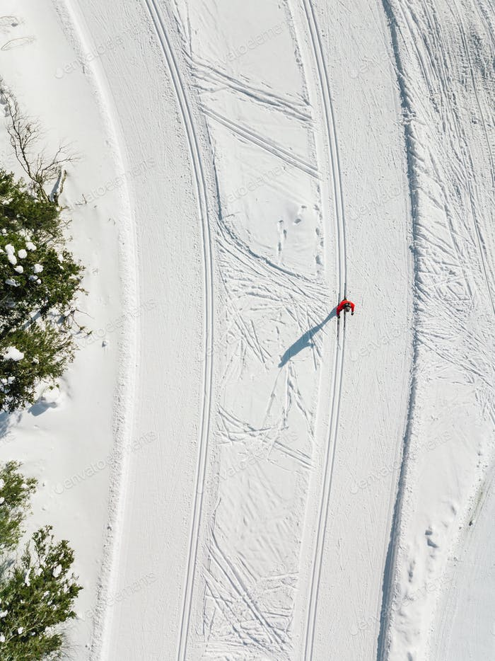Aerial view of ski tracks in snow.  Man skiing in Finland.