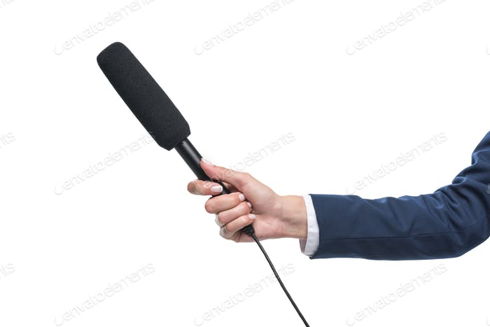cropped view of female hand holding microphone for interview, isolated on white