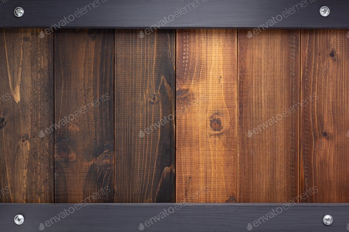 wooden brown and black board with screws
