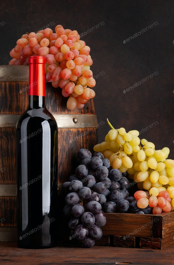 Wine bottle, grapes and barrel