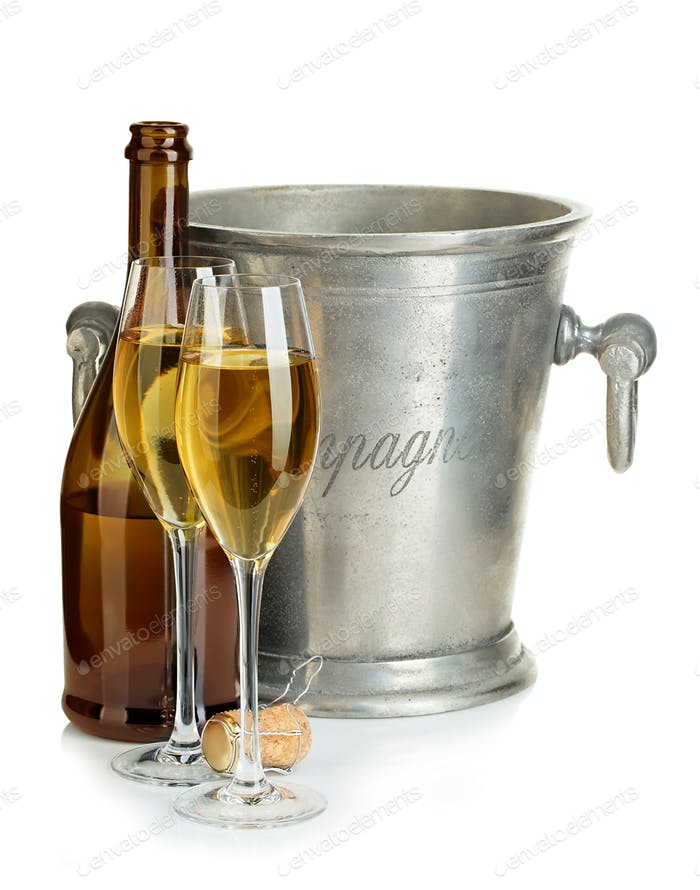 Champagne bottle with ice bucket and glasses of champagne isolated.