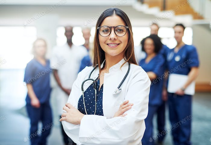 Young pretty female doctor standing in clinic