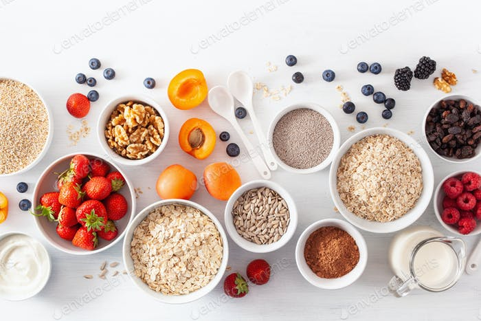 fruits for breakfast. Oatmeal flakes and steel cut, barley, walnut, chia, apricot, strawberry
