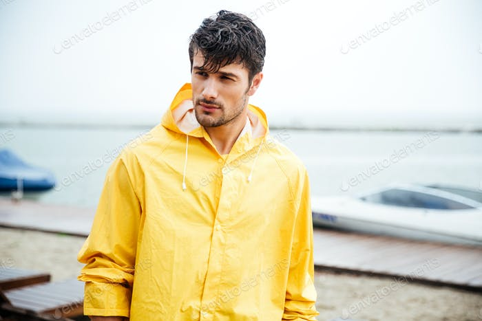 Portrait of a sailor man in yellow cloak