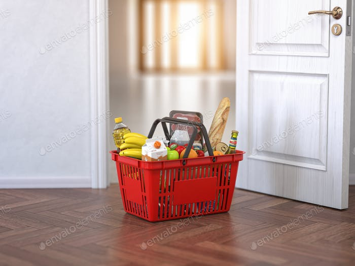 Food and eats delivery concept. Shopping basket with grocery in front of open door.