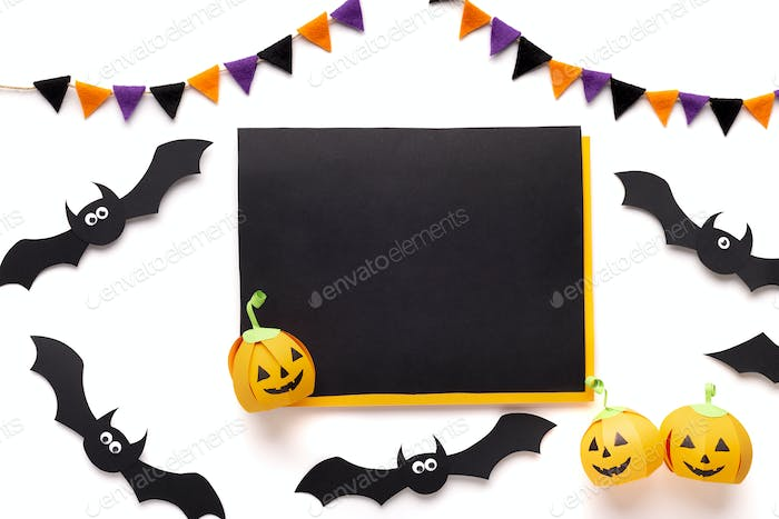 Halloween paper bats and pumpkins on white background
