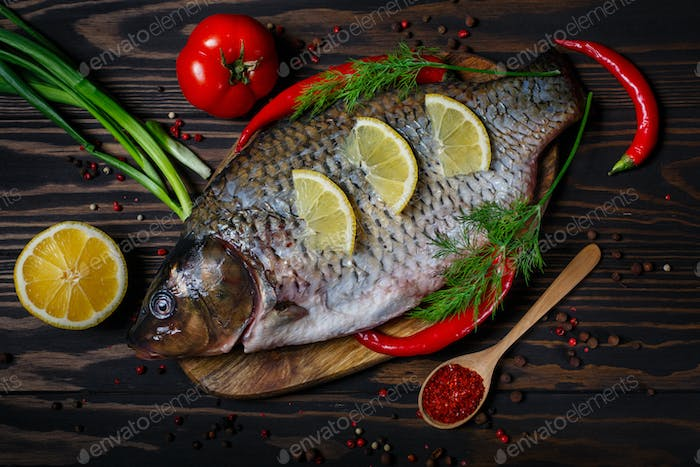 Carp fish with fresh vegetables