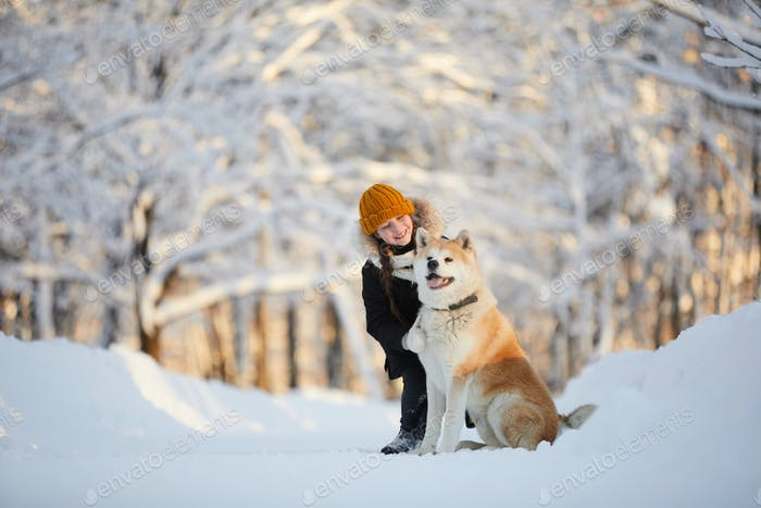 Girl Posing with Akita Dog